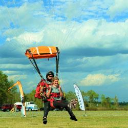 Celebrating their safe tandem skydive near Savannah Georgia